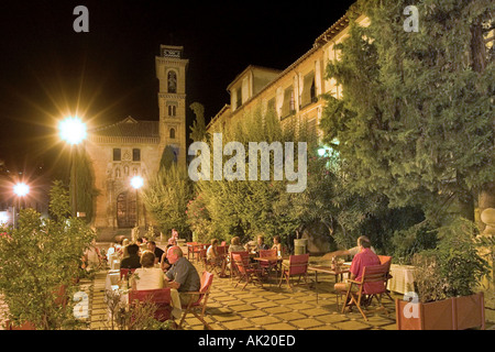 Restaurant at night in front of the Iglesia de Sta Ana, Plaza Nueva, Granada, Andalucia, Spain - Stock Photo
