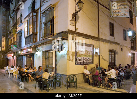People eating in the street in a restaurant near the Plaza Mariana Pineda, Granada, Andalucia, Spain - Stock Photo