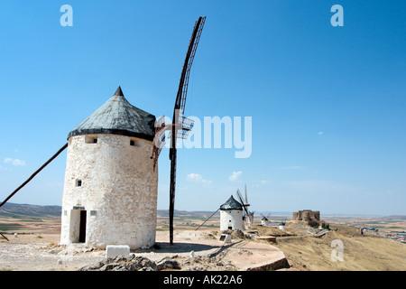 Don Quixote windmills. Famous windmills in Consuegra, Castilla-La-Mancha, Spain - setting for the novel El ingenioso - Stock Photo