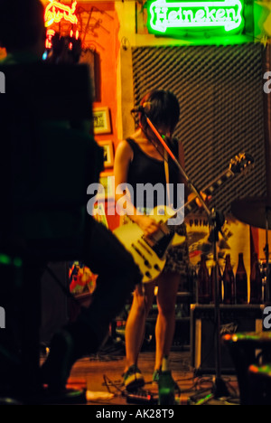 Chinese Girl Musician Playing Electric Guitar Performing In Pub Taiwan China - Stock Photo