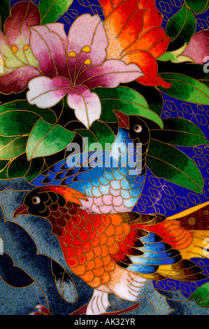 China. Chinese handicrafts, cloisonne plate. Each cloisonne design is hand made with tiny copper wires & powered - Stock Photo