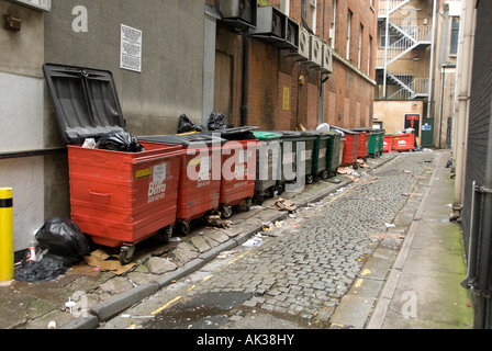 rubbish containers in a street in birmingham used as commercial bins - Stock Photo