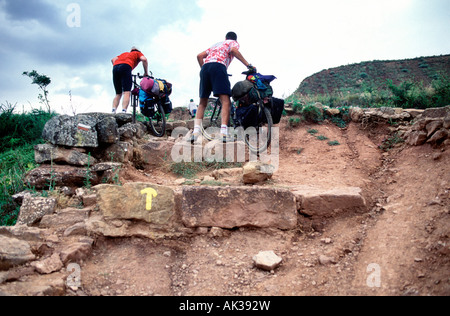 Bikers on the Route of Santiago de Compostela (added to the Unesco's World Heritage List in 1993). Navarra. Spain - Stock Photo