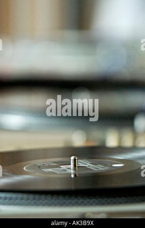 dj mixing records on some decks - Stock Photo