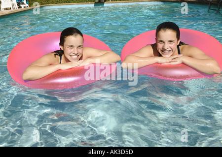 Twin Teenage Girls In A Swimming Pool Stock Photo 1260931 Alamy