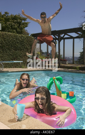 Teenagers playing in a swimming pool - Stock Photo