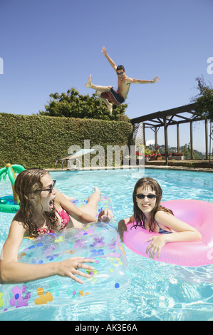 Teenagers getting crazy in a swimming pool - Stock Photo