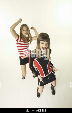 Teenage girls dancing in a studio - Stock Photo