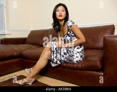 Confident Korean Oriental Woman Sitting On Chair Leaning
