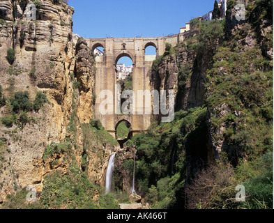 Puente Nuevo The New Bridge over El Tajo gorge and River Guadalevin between medieval and 18th century town view - Stock Photo