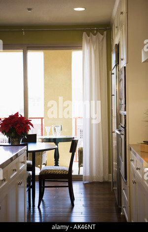 Chair at Dining Room Table with Sliding Glass Door in Background - Stock Photo