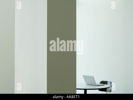 Laptop on table, partial view - Stock Photo