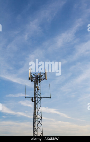 'Mobile phone mast' radio base station against blue sky England UK United Kingdom Great Britain British Isles Europe - Stock Photo