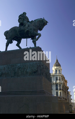 The statue of General Artigas stands in silhouette over his tomb, Independence Square, Montevideo, Uruguay, South - Stock Photo