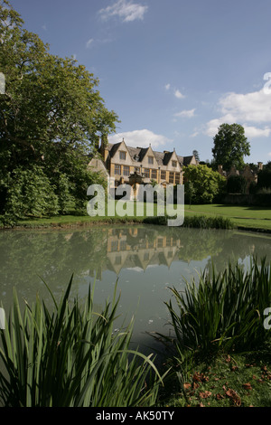 Stanway House in the Cotswold village of Stanway reflected in the lake on a summers day - Stock Photo