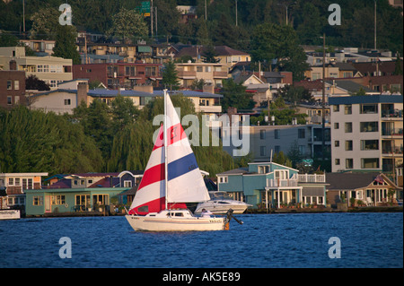 Duck Dodge sailboat race on Lake Union Seattle Washington with houseboats in background - Stock Photo