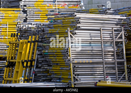 scaffolding piled up on construction site - Stock Photo