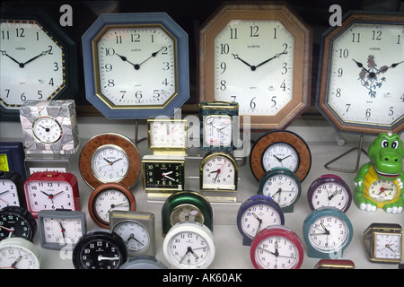 A collection of clocks in store window - Stock Photo