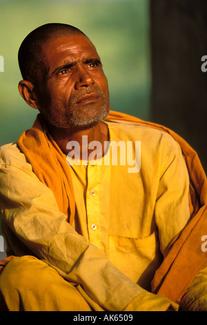 India, Agra, Monk meditating - Stock Photo