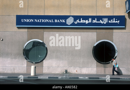 4th April 2003 A man walks past a branch of the Union National Bank in the city of Dubai United Arab Emirates  - Stock Photo