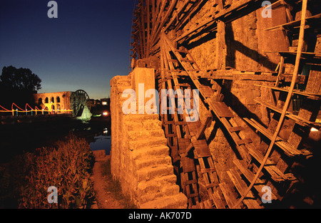 Giant Wooden Water-wheels (or Norias) Line the Banks of the Orontes River in Hama, Syria - Stock Photo