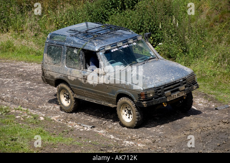 Landrover Discovery on muddy track - Stock Photo