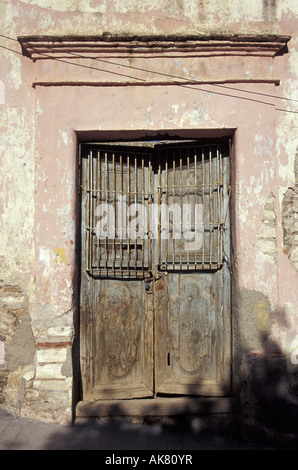 Old door with iron grill, Real de Catorce, Mexico - Stock Photo
