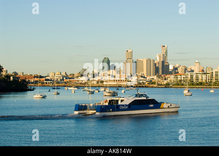 City Cat ferry on the Hamilton Reach of the Brisbane River Downtown Brisbane in background Queensland Australia - Stock Photo