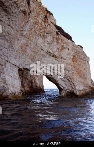 A natural arch in the cliffs at Blue Water Caves, Zakynthos, Greece. - Stock Photo