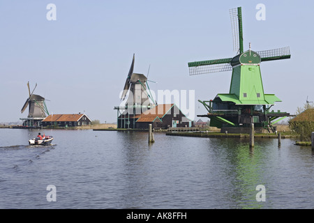 Windmills in open-air museum Zaanse Schans: De Zoeker (left), de Bont Hen (middle), De Gekroonde Poelenburg (right), - Stock Photo