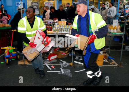 Local Authority workers collecting rubbish from Portobello Market Portobello Road Westminster London UK - Stock Photo