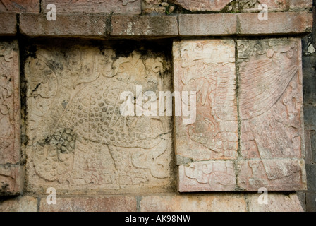 Carving Detail of Eagle and Jaguar Eating Human Hearts on Platform of the Eagles and Jaguars Chichen Itza Yucatan - Stock Photo