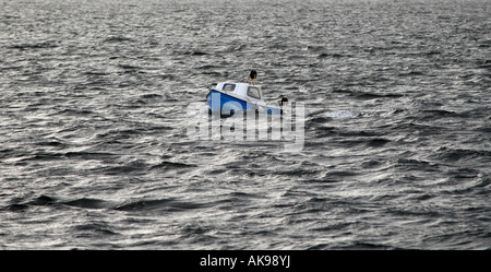 A SMALL FISHING BOAT IN THE WATERS OF THE MORAY FIRTH IN NORTH EAST SCOTLAND,UK. - Stock Photo