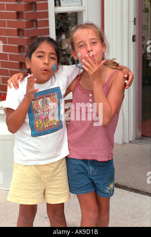 Girls age 11 smoking candy cigarettes at the candy store. Sault Ste. Marie Michigan USA - Stock Photo