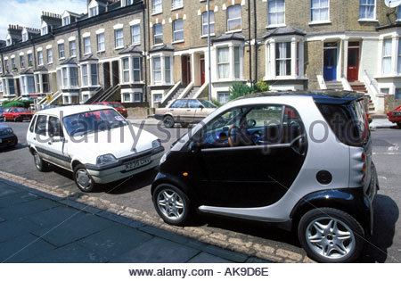 Smart car parked in residential street Finsbury Park North London UK - Stock Photo