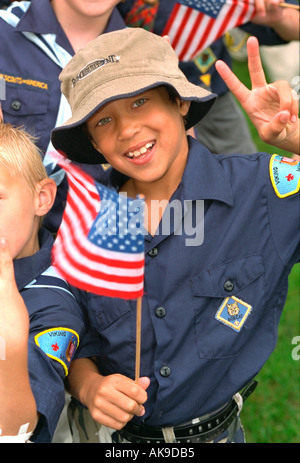 Cub Scout age 11 waving American flag at Parktacular Parade. St Louis Park Minnesota USA - Stock Photo