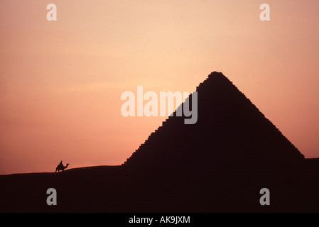 Egypt. Giza Pyramids at sunset. Silhouette at Menkaure. - Stock Photo
