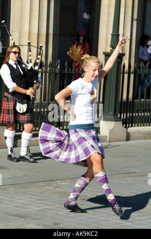 Edinburgh International Festival Scotland UK highland fling dancer fringe street sidewalk performers - Stock Photo