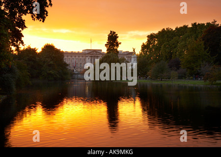View of Buckingham Palace at sunset from St James's Park, London - Stock Photo