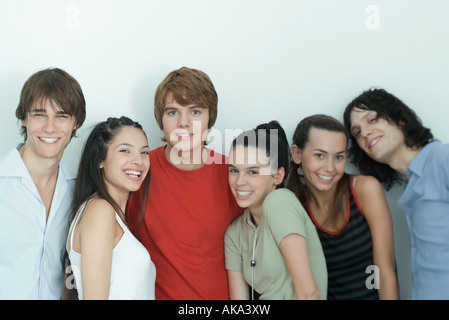 Group of young friends posing for photo, smiling at camera, waist up, portrait - Stock Photo