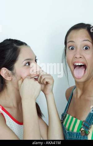 Two young female friends making faces, portrait