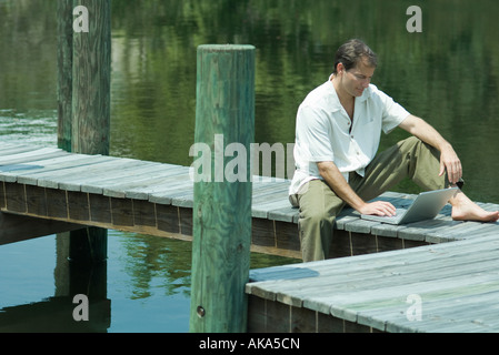 man sitting bare foot on lawn stock photo royalty free image 29436370 alamy. Black Bedroom Furniture Sets. Home Design Ideas