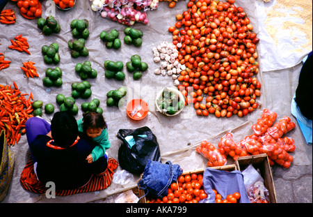 Mother and daughter. Otavalo market. Ecuador - Stock Photo