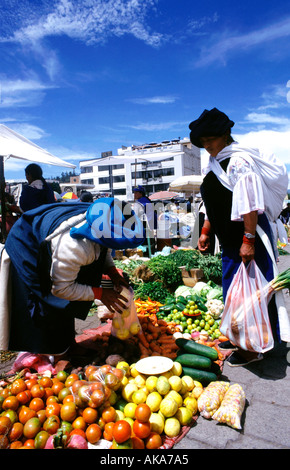 Woman buying fruit. Otavalo market. Ecuador - Stock Photo