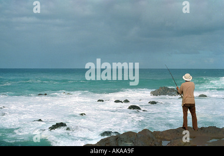 A man with fishing pole at the north pole stock photo for Fly fishing maui