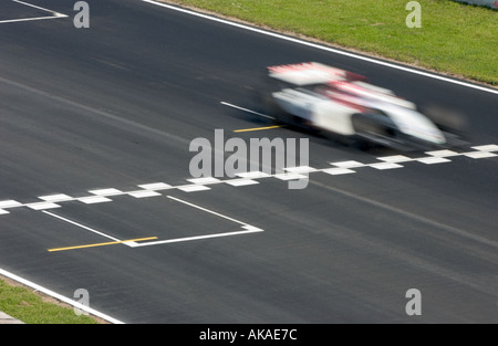 Jenson Button crossing the finish line int he BAR Honda racecar  in 2004 - Stock Photo