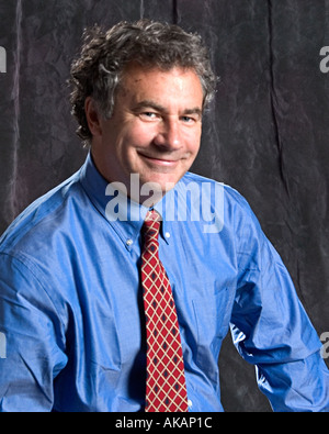 A middle aged business man in corporate attire - Stock Photo