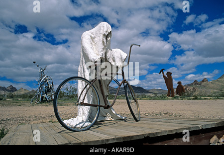 Sculpture of a ghost about to ride a bicycle near Rhyolite, a ghost town in Nevada USA - Stock Photo