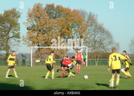Kids playing football match - Stock Photo