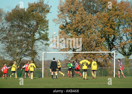 Back view of football referee controlling schoolboy football match     football game - Stock Photo
